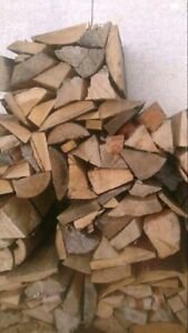 Big bundles of firewood for only six dollars each.