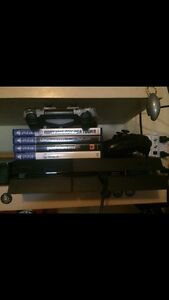 PS4 system, great cond, comes with new controllers and games