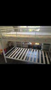 White metal bunk bed with wooden slats