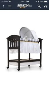 Mobile Wood Crib - almost new