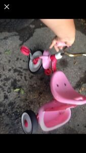 2 pink Tricycles