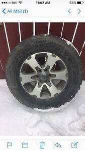4-275x65x18  Tires and rims