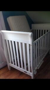 White crib with mattress