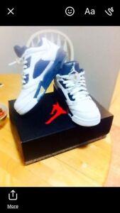 White and blue Jordan 5s