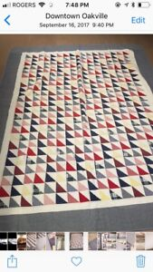 Two twin quilts made by Patch Magic