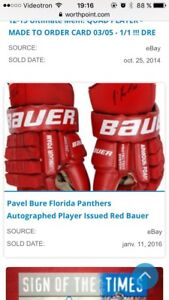 Looking for Pavel Bure game used sticks, gloves...