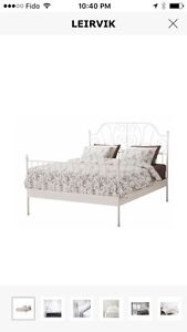 Leirvik IKEA bed frame with wood slats and middle metal bar