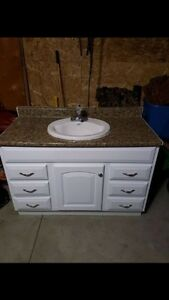 sink, tap, vanity and countertop needs tlc