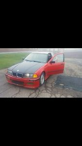 BMW 318i loaded with 2.5 inline 6 engine swap from 325i