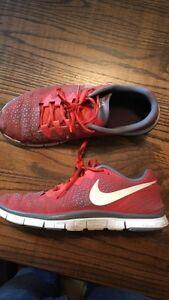 Orange Nike men's running shoes