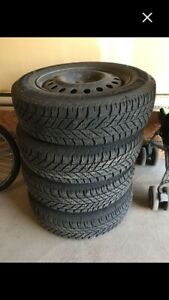 Goodyear Ultragrip winter tires with rims