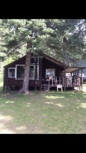 Lakefront property with 2 cabins