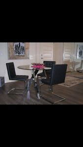 Round Glass Table and 4 Black Chairs