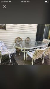 Patio table and 4 chairs with pads.     lower price