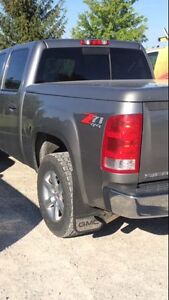 dark grey hard top box coved off a 1500 gmc sierra short box