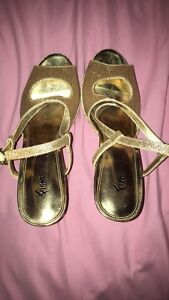 Size 8 gold sparkly heels!