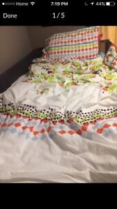 Twin ikea duvet cover and white bed skirt