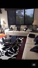 White Leather 3 Seat Sofas x2 Plus 3x Black/Silver Tables Mount Waverley Monash Area Preview