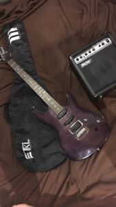 Ibanez electric guitar with amp and sleeve