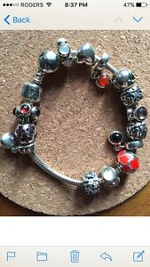 Pandora bracelet with 15 silver charms - USED