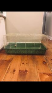 Rabbit/pet cage with hay feeder