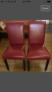 Brand new red leather dinning  chairs $150 for both