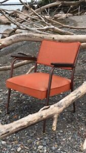 Orange vinyl midcentury vintage arm chair