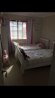 2 white single princess/sleigh timber beds