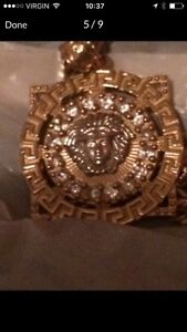 Versace design pendant with gold chain 10 carat