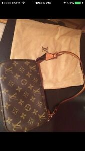 Women's brown Louis Vuitton leather sling bag $400