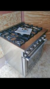 NEW with warranty stoves and warming draws available