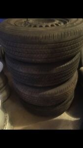 All season tires Goodyear with rims excellent condition