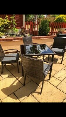 Rattan Brown garden furniture Table  and 4 Chairs Grey Seat Pads