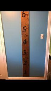 Kids measuring sticks