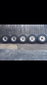 Toyota hilux alloy wheels and tyres 15inch set of 5 genuine 4x4 Revesby Heights Bankstown Area Preview