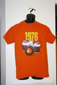 Retro style orange T shirt Canon AE-1
