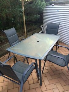 Outdoor Setting - Glass Table with 4 Matching Chairs Greenslopes Brisbane South West Preview