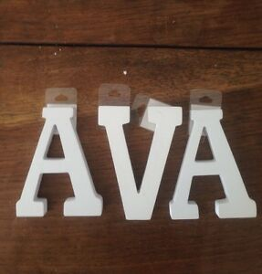 Three white wood art/ craft letters. New. From USA. $10 set. Indooroopilly Brisbane South West Preview