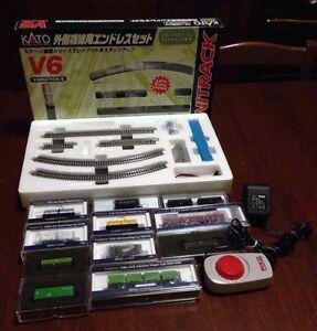 Modellismo; treno merci con locomotore, 11 carri, binario, alimentatore; scala N - Italia - Modellismo; treno merci con locomotore, 11 carri, binario, alimentatore; scala N - Italia