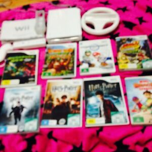 Wii console, x1 control & 1 nunchuck. 8 games South Melbourne Port Phillip Preview