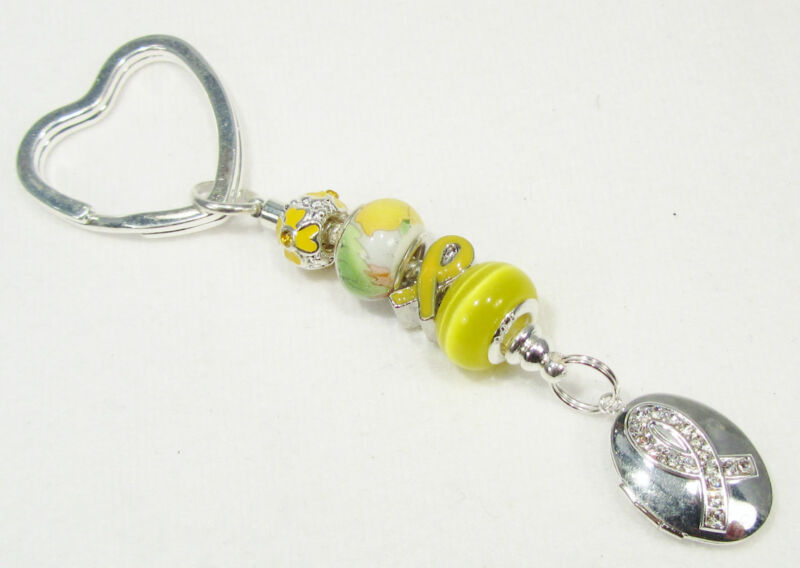 #6177 -- YELLOW RIBBON AWARENESS CHARM SILVERTONE CERAMIC BEADS KEY CHAIN
