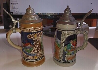 Lot of two 7 inch German Beer Steins with Pewter Lids. Nice!