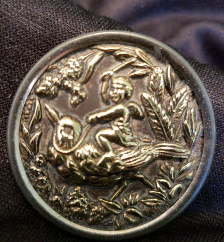 Antique Pressed Brass Picture Button ,Cherub Riding a Robin lg
