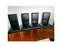 Table and 4 x leather chairs excellent condition *pick up only* Salford