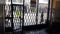 Store front folding security gate & 200 or more wire shelves