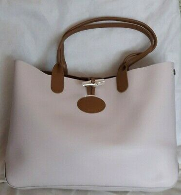 Longchamp: sac roseau en cuir, réversible et transformable.