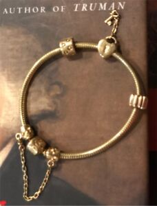 Pandora 14k gold bracelet with charm/clips/safety chain