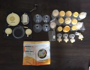 Medela Swing with Symphony Attachments