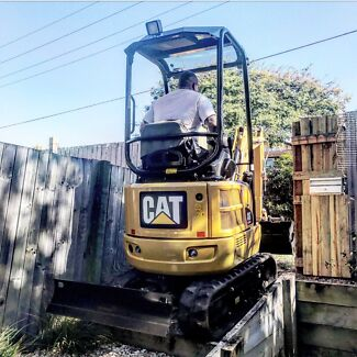 Excavator and post hole auger  $70