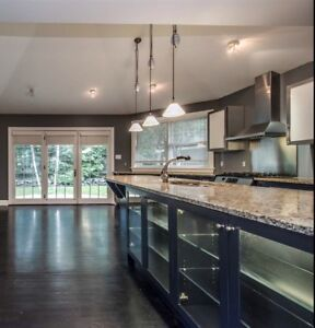Contemporary kitchen cabinets, granite counters, sink, faucet...